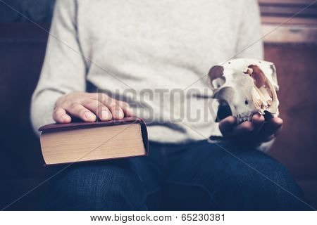 Man On Sofa With Skull And Book