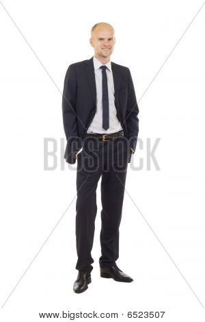 Man In Black Suit With Hands In Pockets