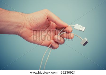 Hand Holding Smart Phone Cable