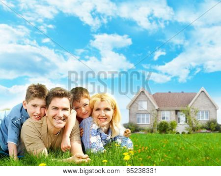 Happy family near new home. Mortgage concept.