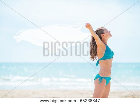 Young Woman With Parero Rejoicing On Beach