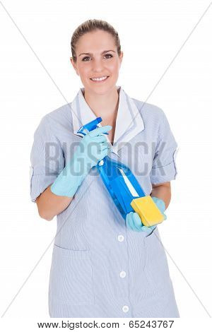 Woman Holding Cleaning Liquid And Scrubber