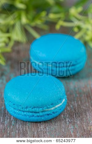 Light Blue French Macarons With Buttercream On A Wooden Table.