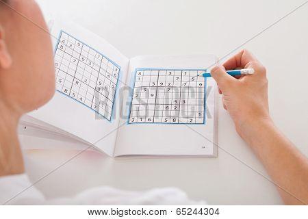 Woman Solving Sudoku