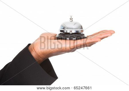 Close-up Of Hand Holding Service Bell