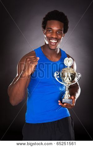 African Man With Trophy