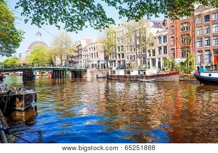 Amsterdam, Netherlands.-APRIL 23: Amsterdam canals on April 23, 2014. Beautiful view of Amsterdam canals and typical dutch houses.