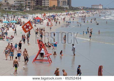 JACKSONVILLE BEACH, FL-MAY 18, 2014: Crowds enjoying Jacksonville Beach on a weekend. Jacksonville Beach is 15 miles east of Jacksonville and has a population of 21,362 at the 2010 census.