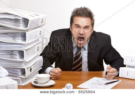 Stressed Business Man Screams Frustrated In Office Between Folder Stack