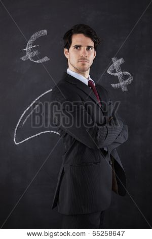 Businessman with a shark fin draw on the blackboard