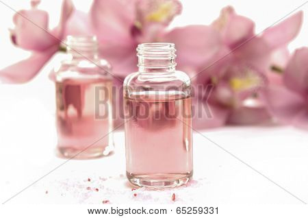 Aromatherapy oil and branch orchid flowers