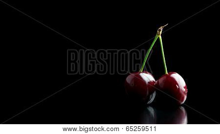 Two Ripe Red Cherries