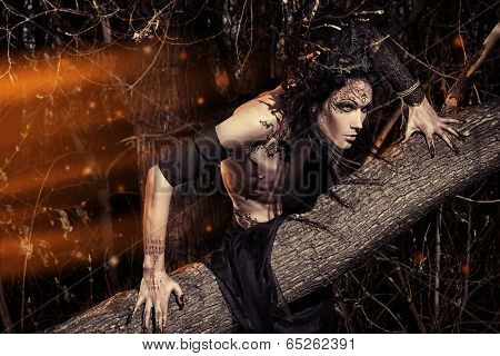 Man-tree in a wild wood. Art project. Fantasy. Halloween.