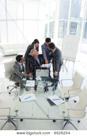 Businessman Pointing To A Document In A Meeting