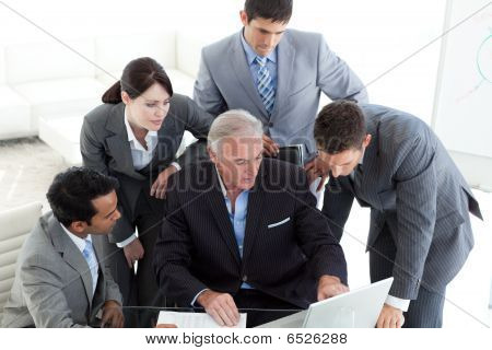 Concentrated Business Team Working At A Computer