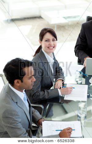 Businesswoman In A Meeting Smiling At The Camera