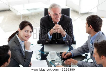 Multi-ethnic Business People Sitting Around A Conference Table