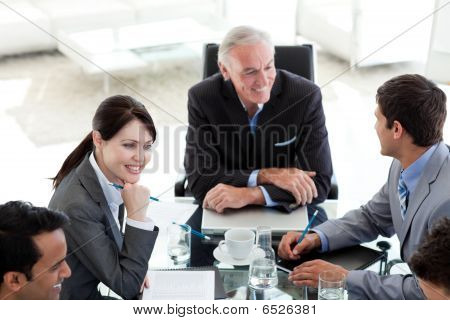 International Business People Discussing A Business Plan