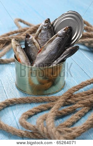 Dried Fish In A Tin On Blue Boards