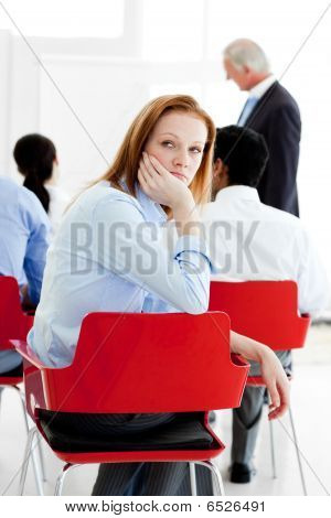 Young Businesswoman Bored At A Conference
