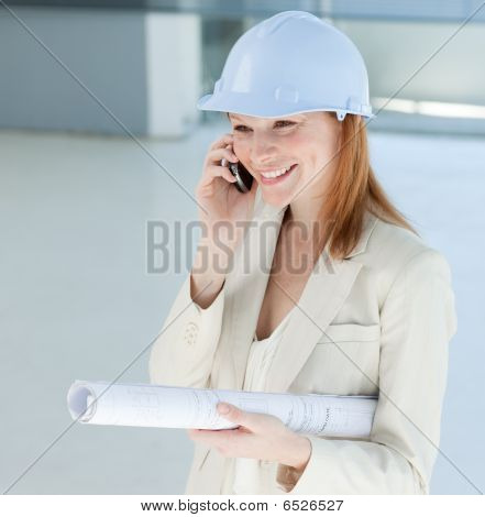 Young Female Engineer On Phone