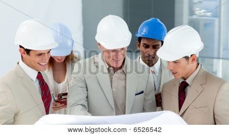 A Group Of Architect Discussing A Construction Plan