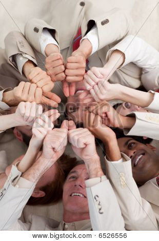 Multi-ethnic Business People With Thumbs Up Lying On The Floor