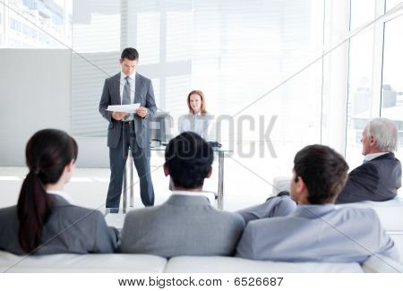 A Diverse Business People At A Conference