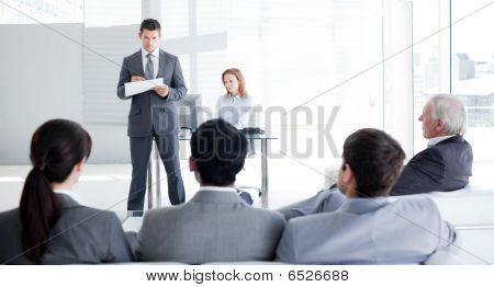 A Teamleader Talking To His Colleagues
