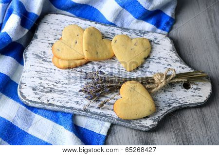 Lavender cookies on cutting board, on color napkin background
