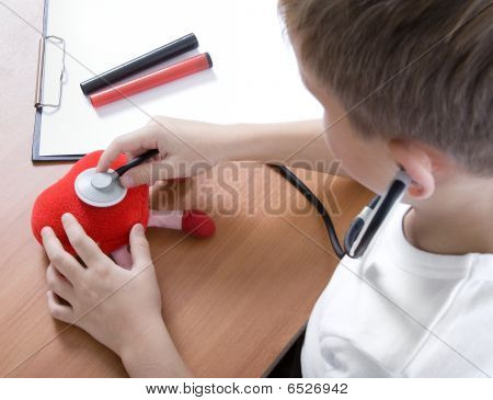 Boy Playing Doctor With Stethoscope