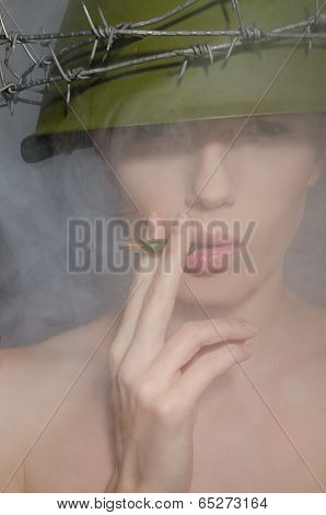 Portrait Of Woman In Fog With A Helmet