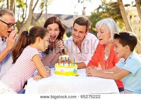 Multi-Generation Family Celebrating Birthday In Garden