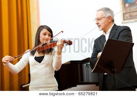 Violin teacher helping a student at the conservatory