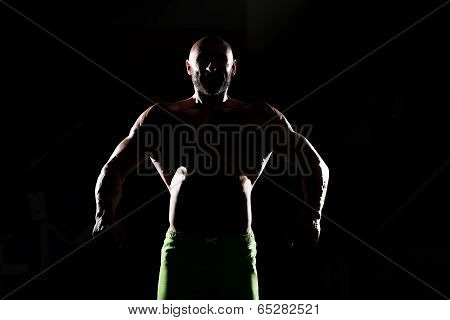 Siluet Muscular Man Flexing Muscles