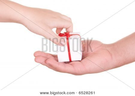 Two Hands And Box With  Gift