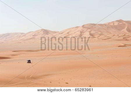 Car Among Sand Dunes In Oman Desert (oman)