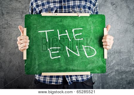 Man Holding Green Chalkboard With The End Title