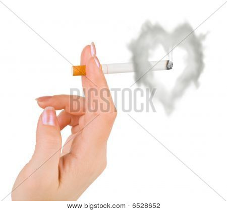 Hand With Cigarette And Heart Shaped Smoke