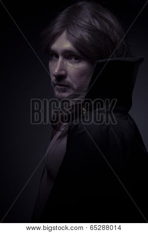Evil man with long hair and black coat
