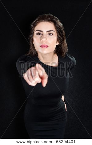 Closeup portrait of serious young woman pointing