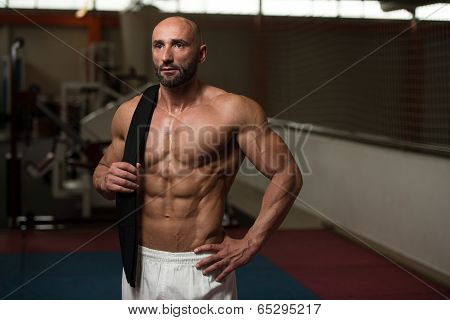 Sexy Muscular Man With Black Belt On Shoulder
