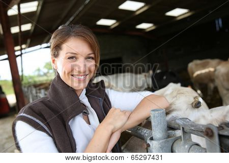 Smiling breeder standing in barn