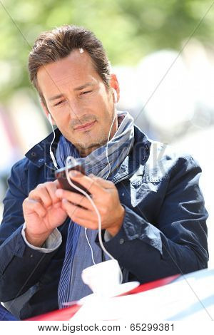 Middle-aged man talking on phone with handsfree
