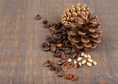 stock photo of pine nut  - Cedar pine nuts on wooden table - JPG