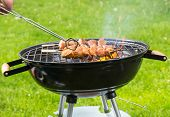 foto of barbie  - Delicious grilled chicken skewers on fire - JPG
