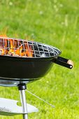 picture of ember  - Empty grill on garden with burning embers - JPG