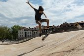 stock photo of skateboarding  - Young boy skateboarder at the local skatepark - JPG