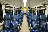 stock photo of passenger train  - Interior of a passenger train with empty seats - JPG