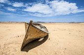 stock photo of ica  - Boat in the desert Paracas National Reserve Ica Region Peru - JPG